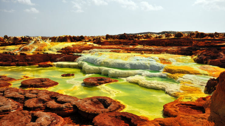 Sulphurous yellow mounds and volcanoes at the Danakil Depression Ethiopia.