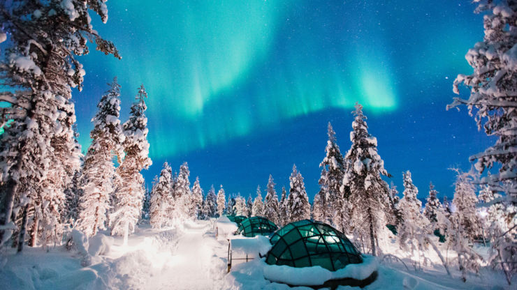 The Northern Lights over Kakslauttanen glass igloos (credit to Valtteri Hirvonen)
